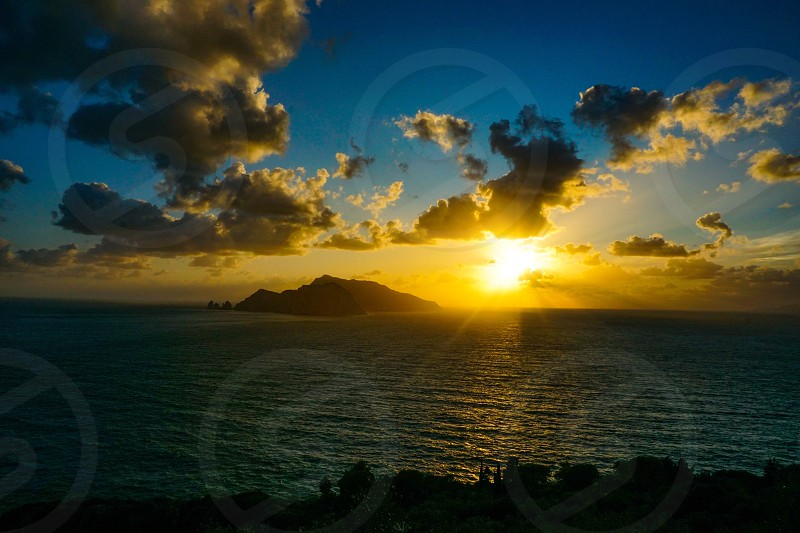 Capri island Naples bay at sunset seen from Punta Campanella photo