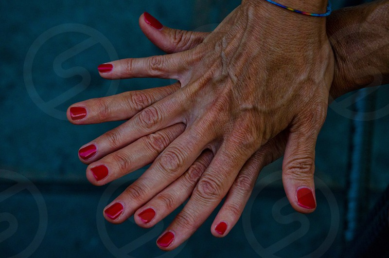 person with red manicure photo