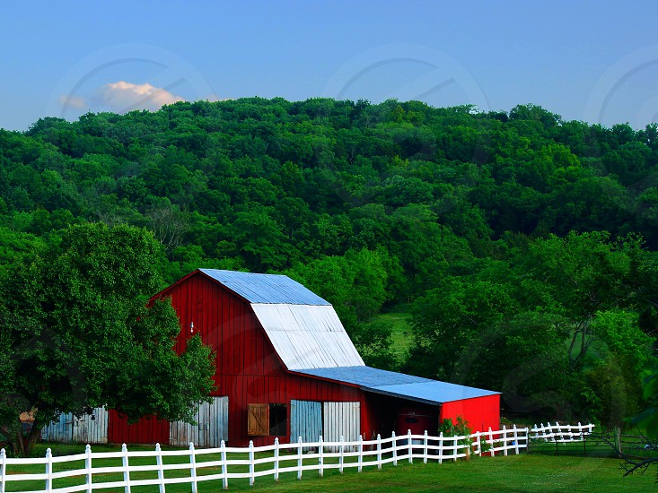 view of red white and blue wooden barn photo