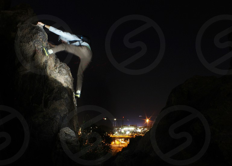 We hiked on top of a high spot to rock climb and do long exposures with the stadium in the backround. My friend who is a good rock climber held this position for 3 1/2 minutes in order for me to light him up and get a good long exposure shot. photo