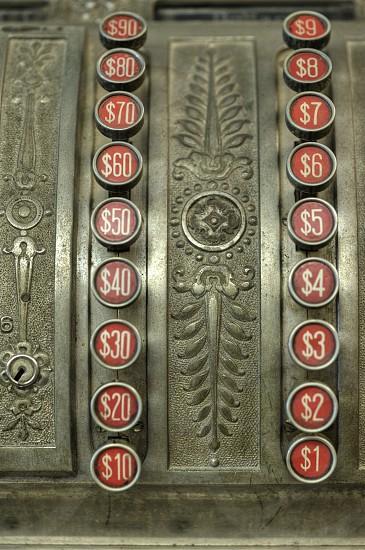Old Antique cash register buttons. photo