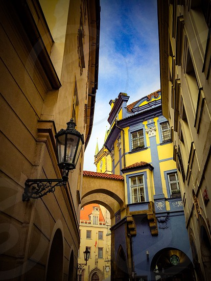 Outdoor day vertical portrait colour shops alley buildings architecture sky colourful painted traditional. Prague Czech Czech Republic travel tourist tourism wanderlust east eastern Europe European photo