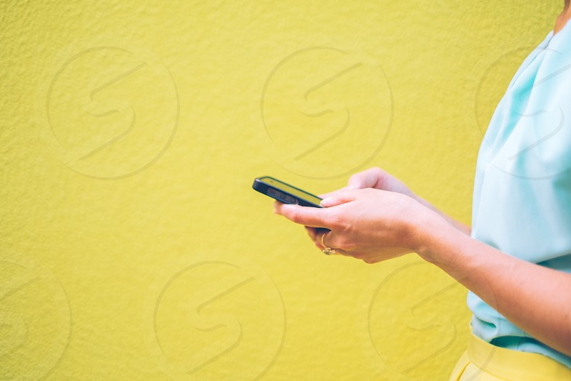 Woman using mobile device photo