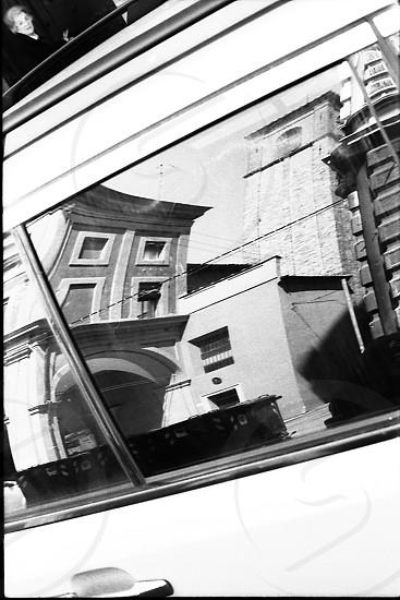 Bologna reflecting on a car photo
