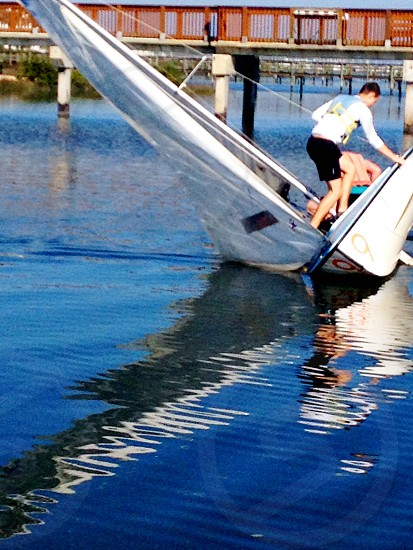 Capsizing boat photo