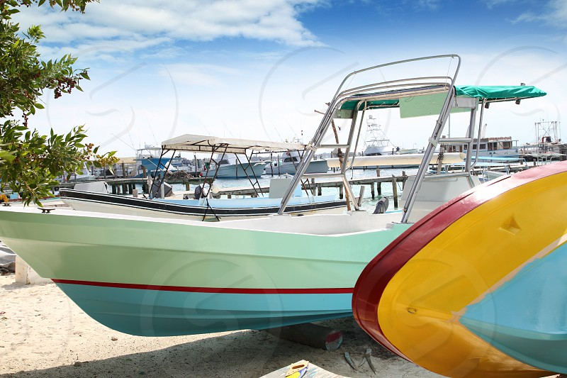 boats colorful in Isla Mujeres beach Mexico Mayan Riviera Cancun photo