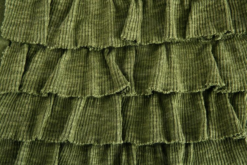 pleated skirt fabric fashion in green closeup macro photo