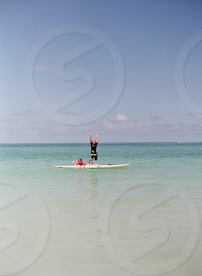 Summer fun beach lifestyle stand up paddle board supocean Florida family photo