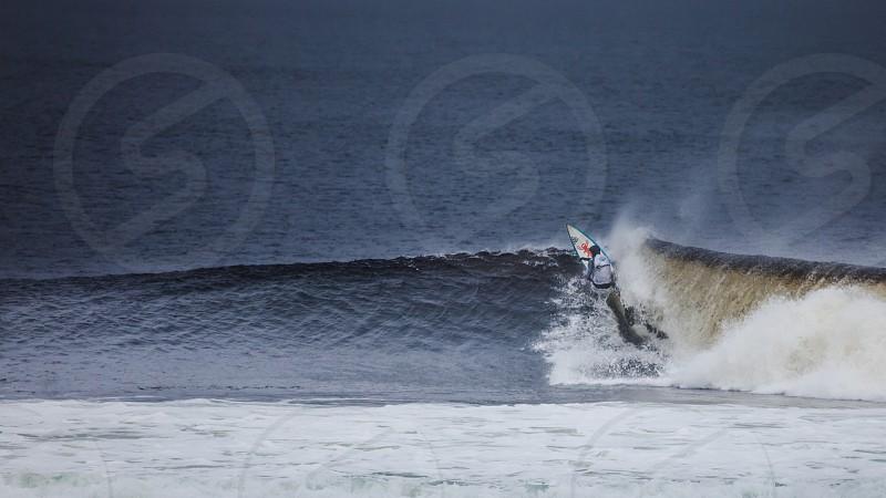 surfer surfing on huge ocean wave during daytime photo