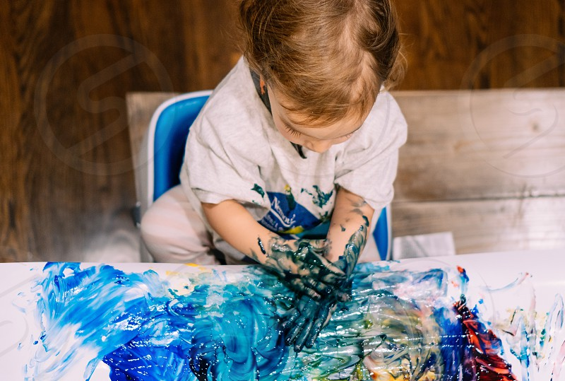 Let toddlers be messy; finger painting  photo