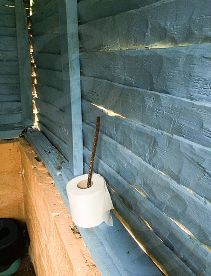 A role of toilet paper in a  mountain shed restroom. photo