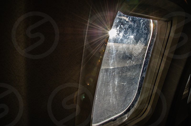 Sunlight shining through the window of an aeroplane in flight. photo