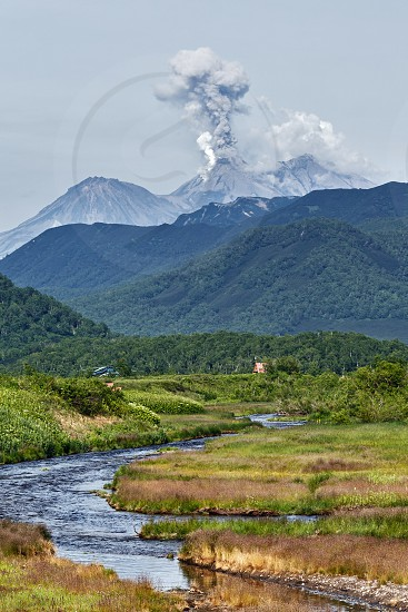 Beautiful volcanic landscape of Kamchatka: view of erupting active Zhupanovsky Volcano on Kamchatka Peninsula - explosive-effusive eruptions gas-steam activity of volcano. Eurasia Russian Far East. photo