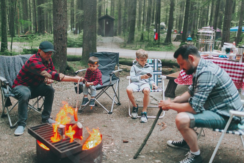 Fathers and snow around a campfire. photo