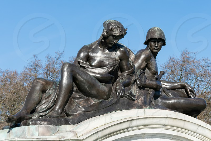 Statue on the Queen Victoria Memorial outside Buckingham Palace in London photo