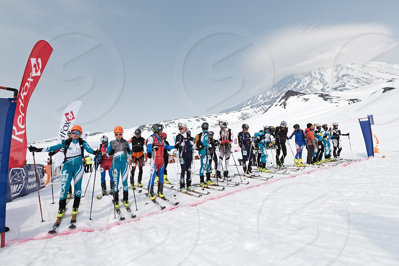 AVACHA AND KORYAK VOLCANOES KAMCHATKA RUSSIA - APRIL 27 2014: Sportsmans ski mountaineers at the starting line. Team Race ski mountaineering Asian ISMF Russian Kamchatka Championship. photo