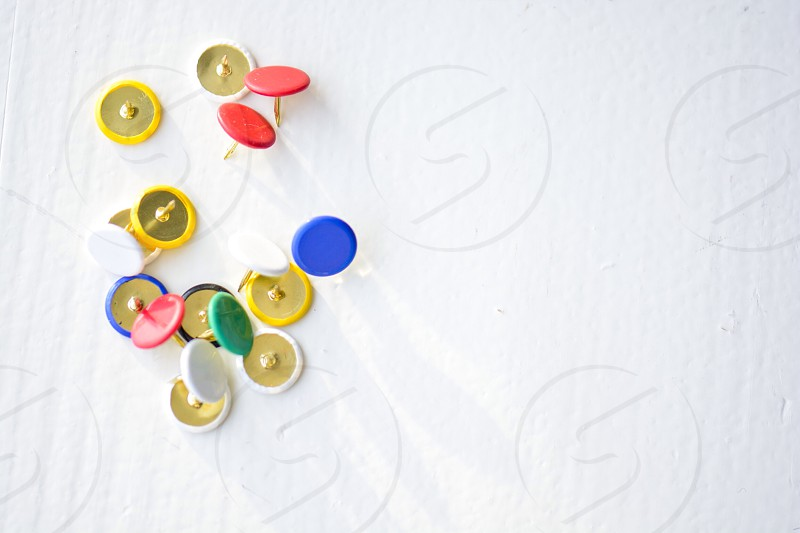 Pinning it down pins white background  photo