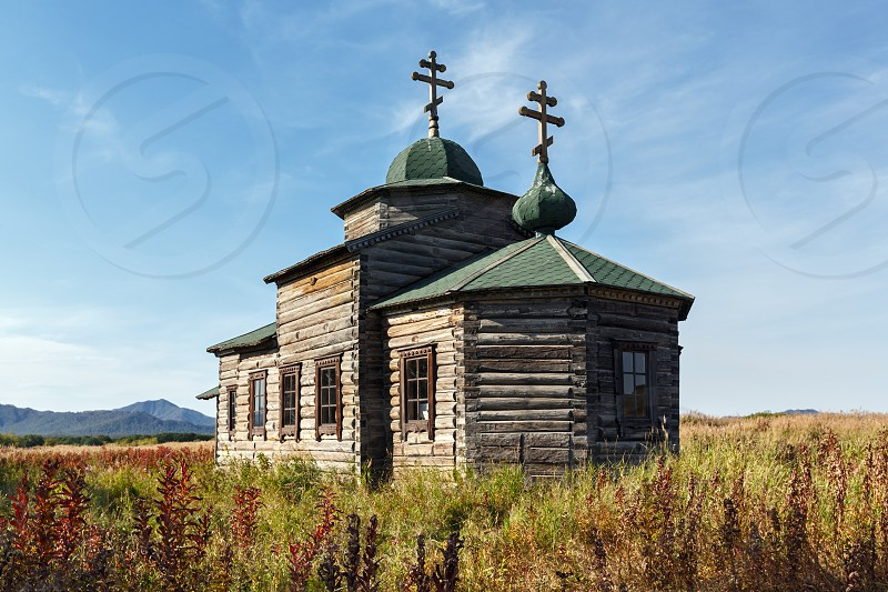 KAMCHATKA PENINSULA RUSSIA - SEPTEMBER 19 2015: View on ancient wooden Orthodox Church of Assumption (Church of Dormition). Church is located in former settlement Nizhnekamchatsk built in 1864. photo