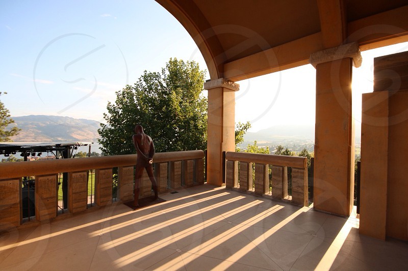man standing on the balcony photo
