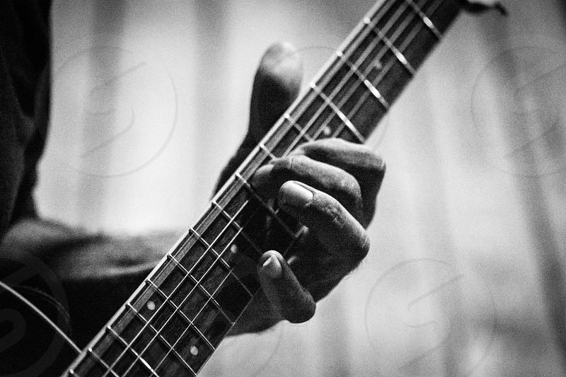 music musician guitar strum finger fingers black white B&W play gritty chord photo