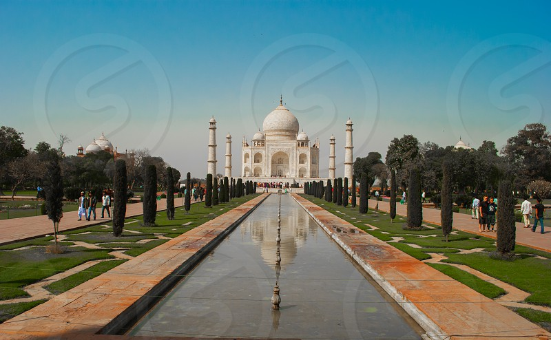 The Taj Mahal (meaning Crown of the Palace) is an ivory-white marble mausoleum on the south bank of the Yamuna river in the Indian city of Agra. photo