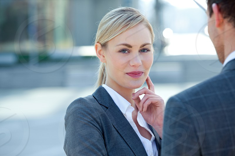 Portrait of a businesswoman standing with her hand on her chin photo