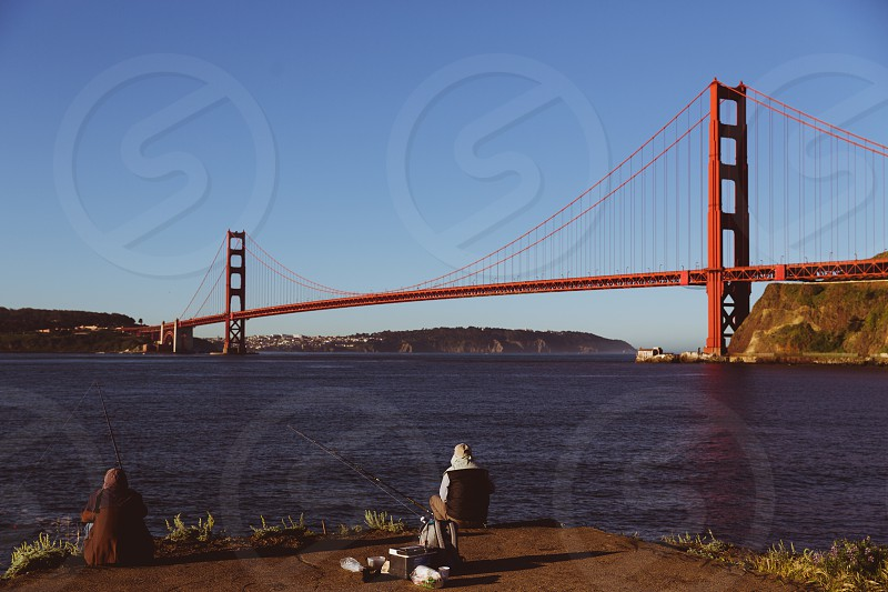 golden bridge golden gate bridge bridge san francisco usa california iconic icon red sunset landscapeperson walking sport outdoor fishing fish guy people leisure grandpa photo