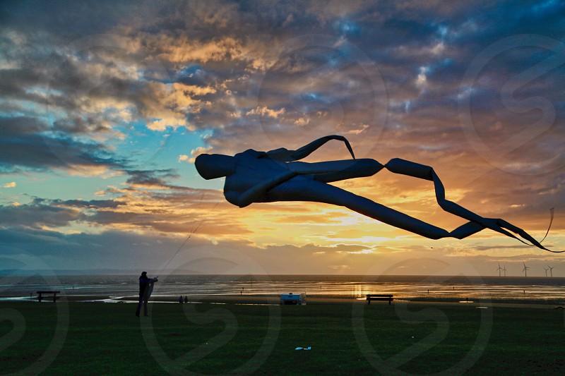 Kite flying sunset photo