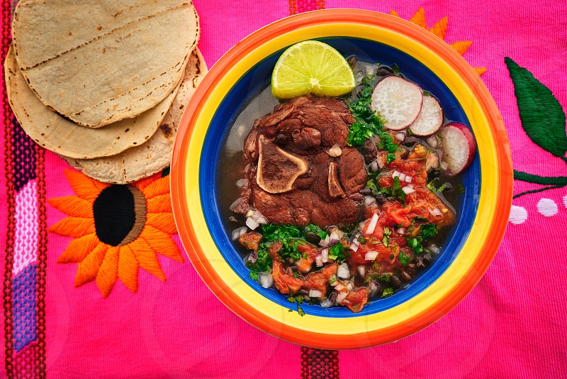 Mexican beef recipe with frijoles coriander and tortillas photo