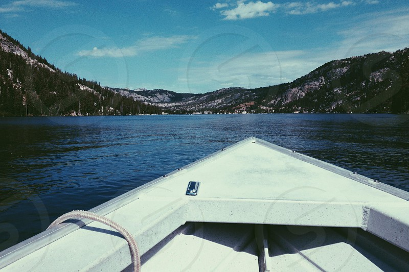 Front of boat forms a triangle in the Sierras  photo