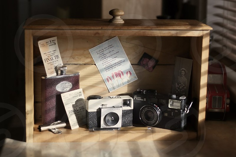 An old draw used for shelving with treasures & trinkets that belonged to my parents. photo