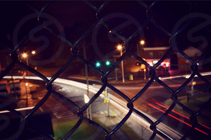 cyclone fence on street photography photo