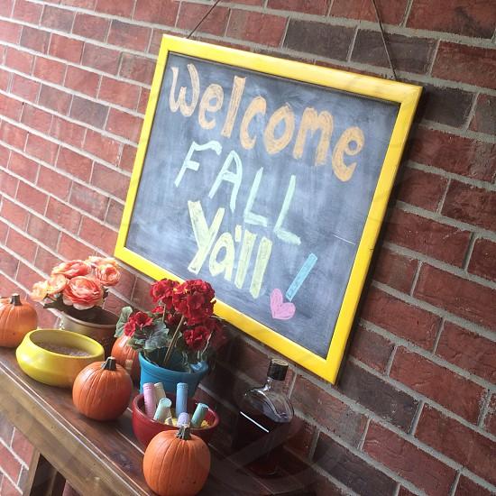 Chalkboard; outdoor sign; chalk art; welcome; brick wall photo