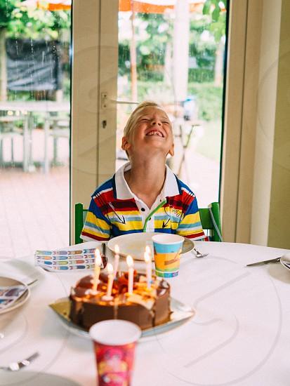 Birthday boy kid cake candle party photo