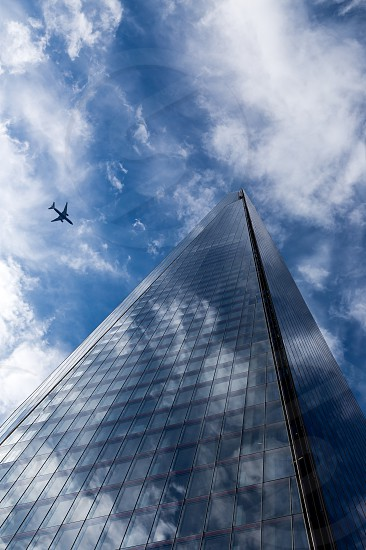 airplane in the background of a skyscraper photo