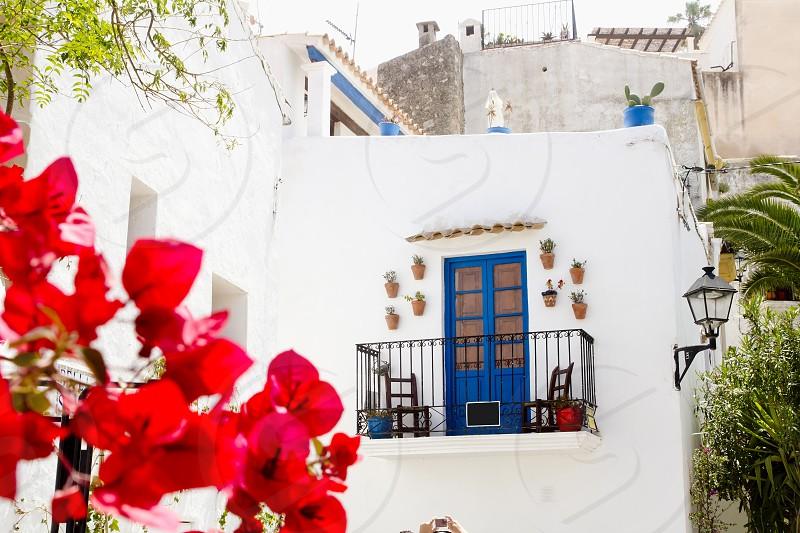 Ibiza white island architecture corner bougainvilleas flowers Balearic Spain photo
