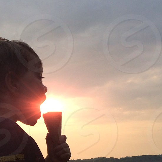 child holding ice cream cone photo
