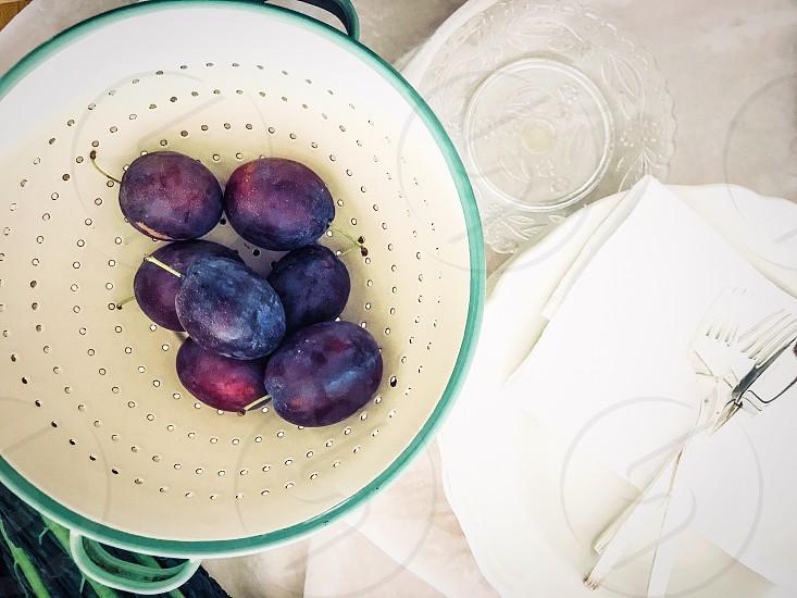 Circles circle plums fruit drain plates holes kitchen utensils top perspective  photo