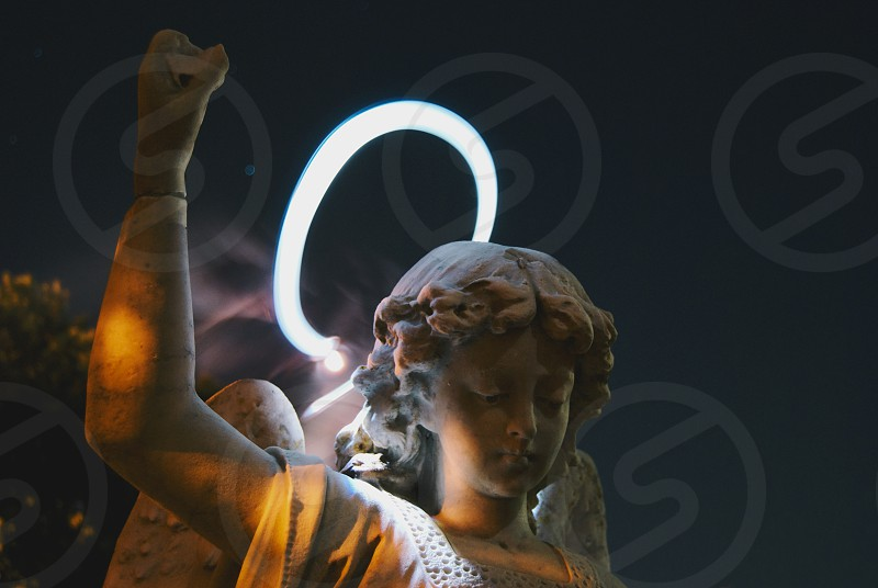 Angel statue with a light halo photo