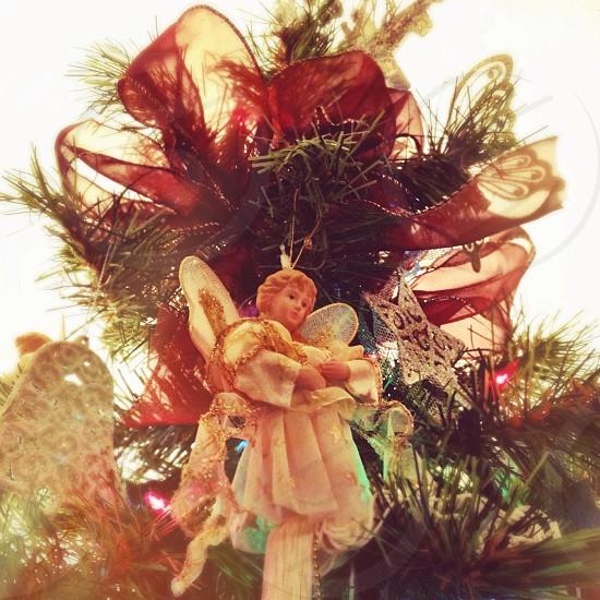 angel figure hanging on christmas tree photo