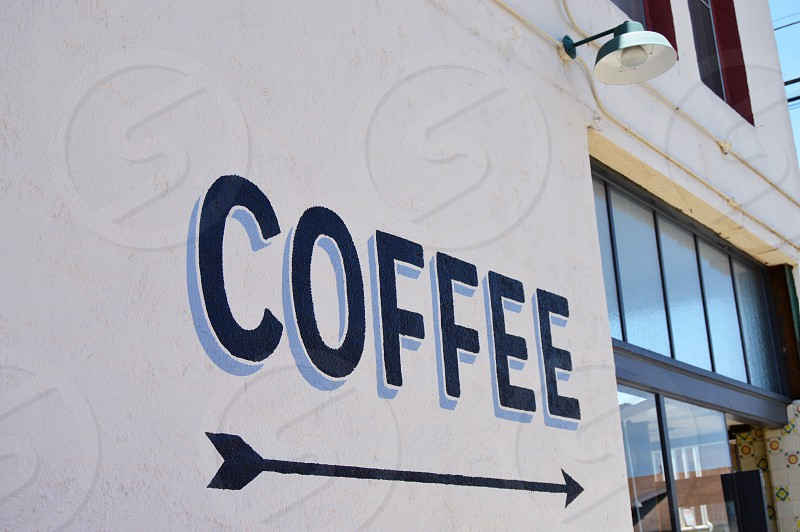 Coffee and arrow pointing door painted signage photo