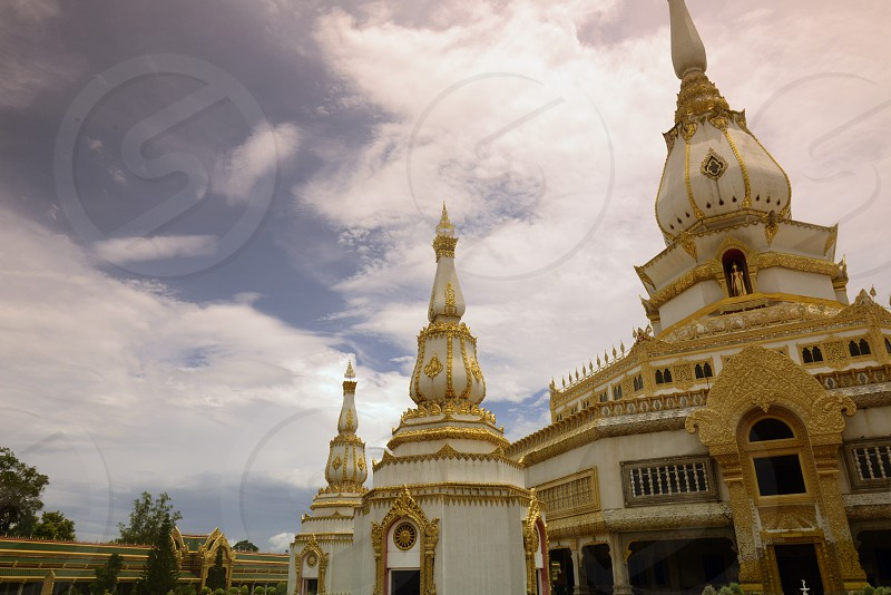 the large Temple or Chedi Phra Maha Chedi Chai Mongkhon on a hill near Roi Et in the  Provinz Roi Et northwest of Ubon Ratchathani in the Region of Isan in Northeast Thailand in Thailand.