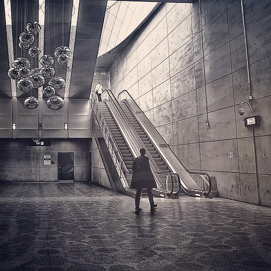 man walking through the escalator photo