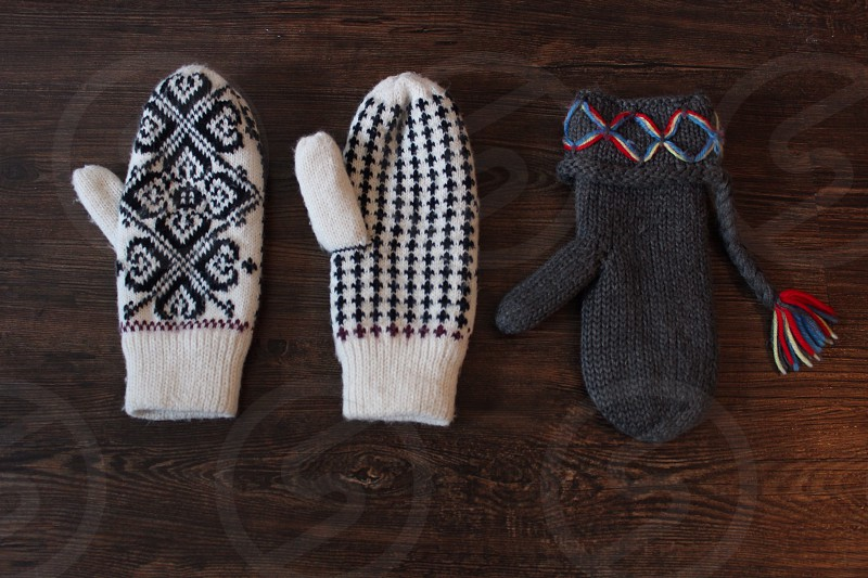 Knitted gloves with different patterns photo