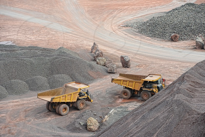 dumper trucks parking in a surface mine. mining industry. photo