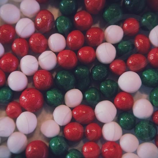 green red white balls photo