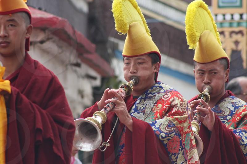 Tibetan ritual preceding the Losar celebration and Mask Dance of ancient Bon Tradition. Dharmsala India Tibetan Buddhism Prayers Ceremony Tibetan horn Monastery. photo