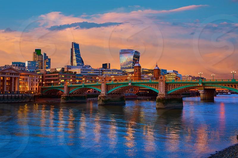 London skyline sunset in Southwark bridge at Thames river UK photo