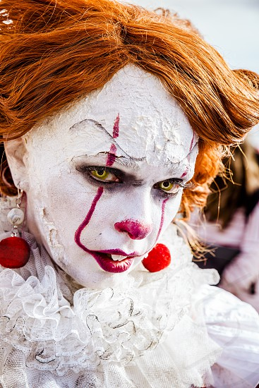 Lucca Italy 03/11/2018: Cosplayer disguised as a scary clown during the manifestation of the Lucca Comix 2018 photo