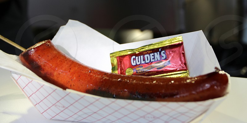 Earl Campbell Hot Link sausage eight inches with stick and Gulden's mustard  state fair fod photo